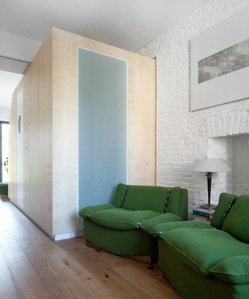Turin apartment renovation green armchairs