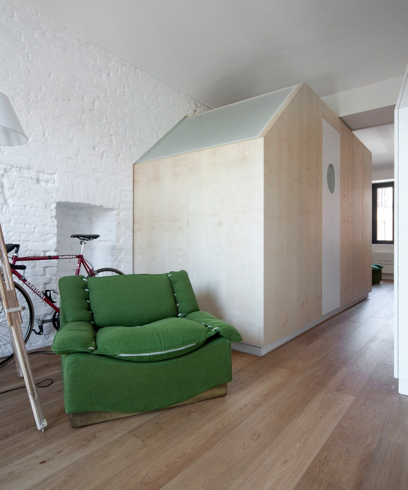 Turin apartment renovation wooden cube volume
