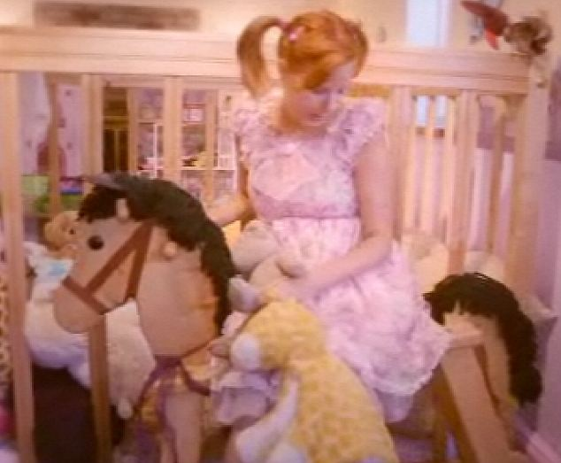 This adult baby lives in a bedroom filled with over sized toys to make her feel